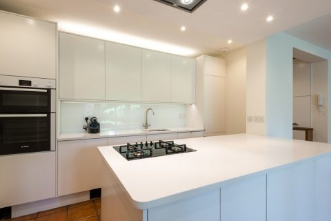 Customized kitchen with quartz worktop by South London kitchen fitters
