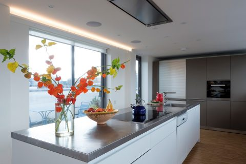 Kitchen by South london kitchen fitters with stainless steel worktop