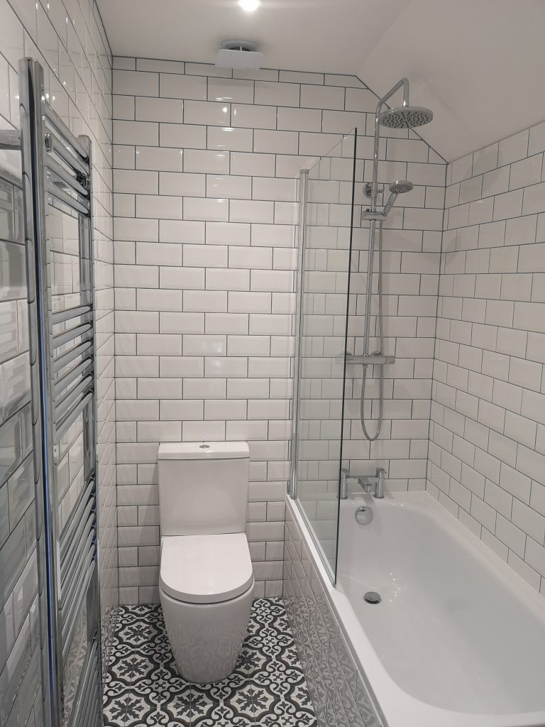 bathroom with white metro tiles and grey grout by south London kitchen and bathroom fitters
