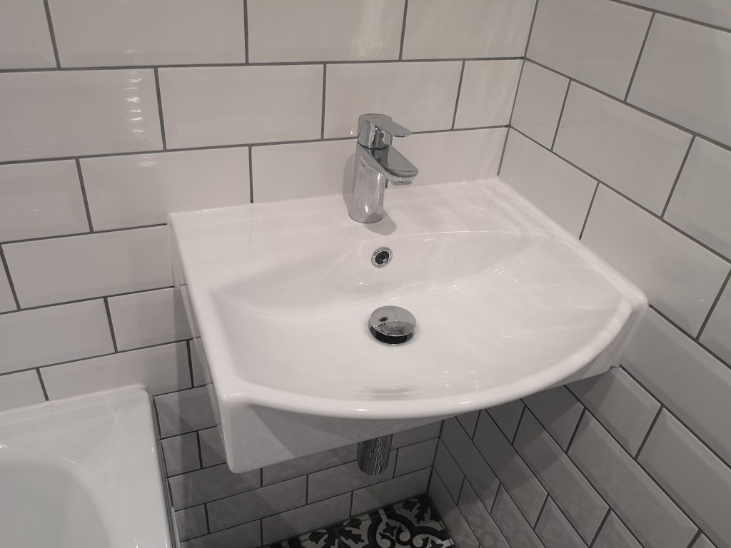 white metro tiles with grey grout, wall hang modern basin