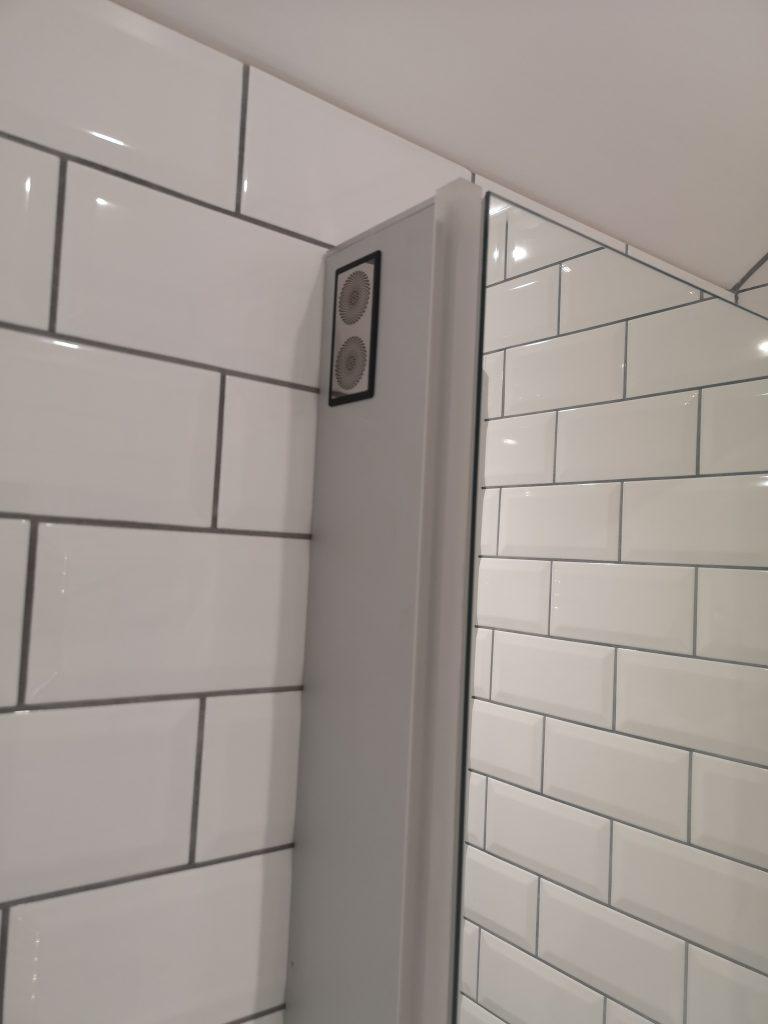 white metro tiles, bluetooth speaker cupboard